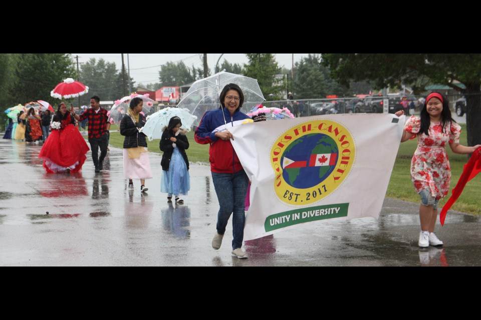 Okotoks Fil-Can Society members make their way through Longview in the Little New York Daze parade Saturday morning.