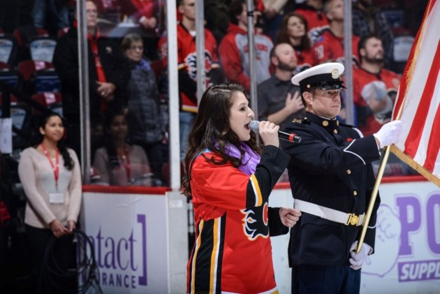 Michela Sheedy sings the Canadian and American national anthem at the Calgary Flames-New Jersey Devils on Nov. 5 at the Scotiabank Saddledome.