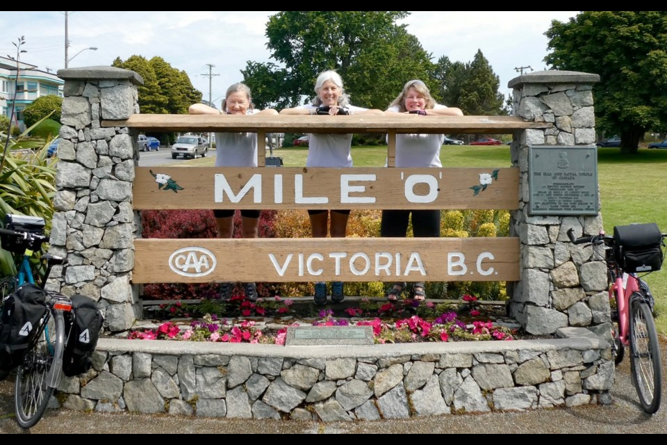 Nynka Greer, left, Jane Sorensen and Kathy Manners are shown in Victoria, B.C., at the zero-km mark of their cross-Canada cycling trip. Supplied photo