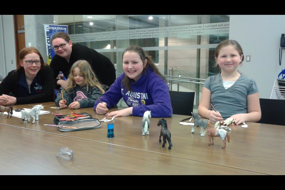 Members of the Horseshoe Pony Club gather at the Orillia Public Library . The next meeting is March 20. Contributed photo