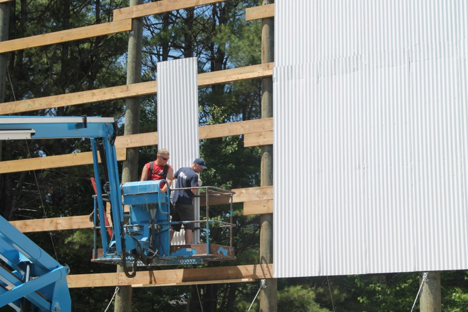 Workers construct a new screen at the Muskoka Drive-In Theatre in Gravenhurst. Contributed photo