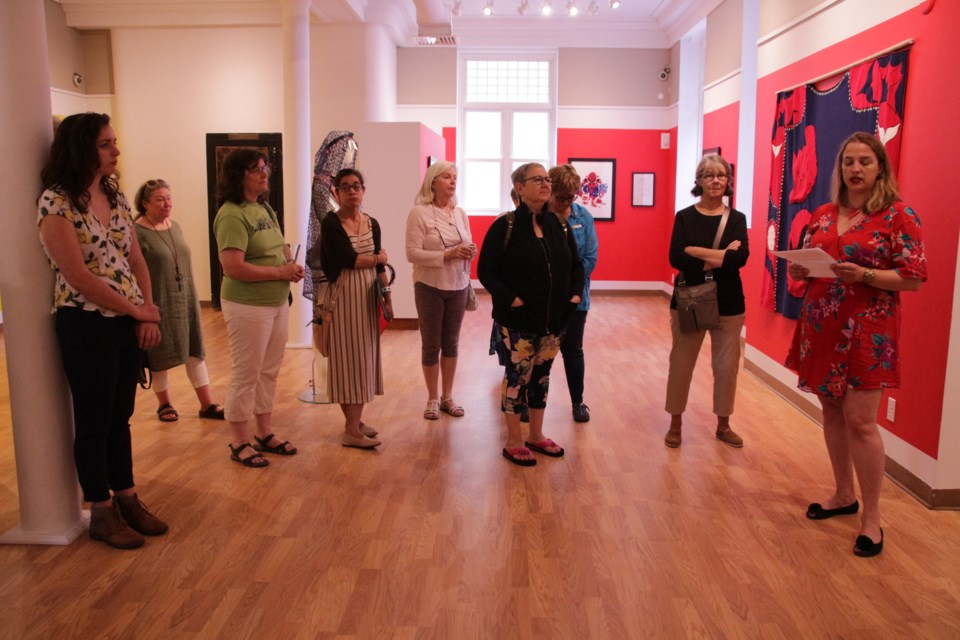 Ninette Gyorody, right, executive director, of the Orillia Museum of Art and History, offered a land acknowledgement as part of her opening words as a new exhibit, When Raven Became Spider, opened Saturday. Mehreen Shahid/OrilliaMatters
