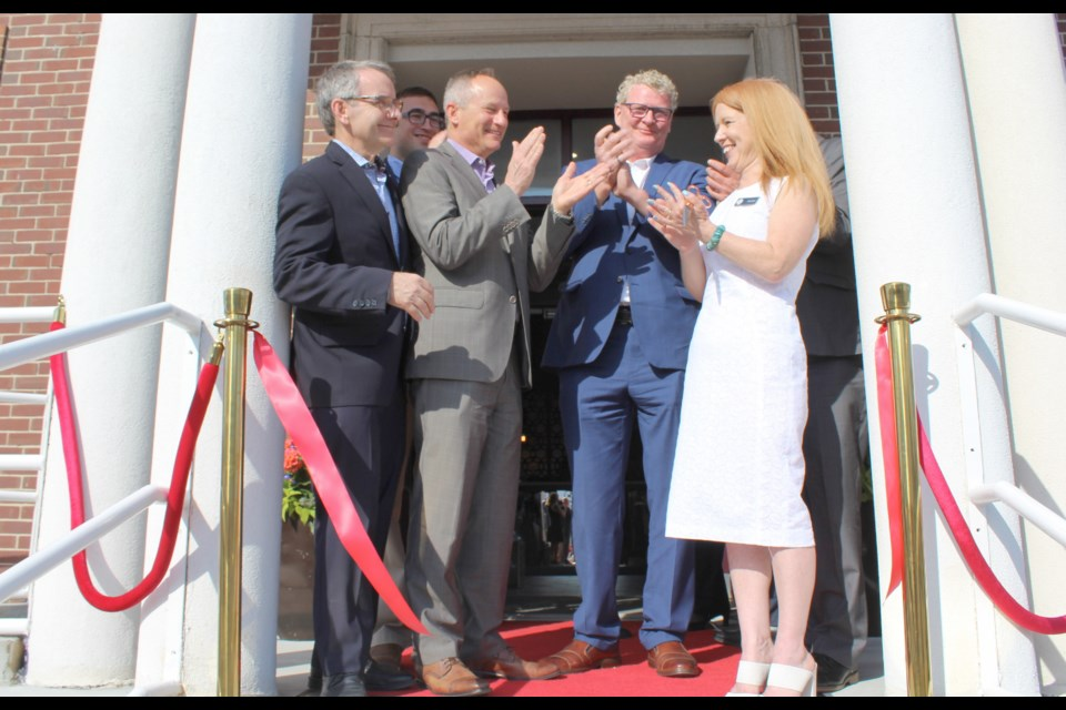 Applause as the ribbon is cut Tuesday during the grand opening of the Champlain Waterfront Hotel. From left: Simcoe North MP Bruce Stanton, Coun. Mason Ainsworth, Choice Hotels Canada president Brian Leon, Mayor Steve Clarke and hotel manager Jacquie Jibb. Nathan Taylor/OrilliaMatters