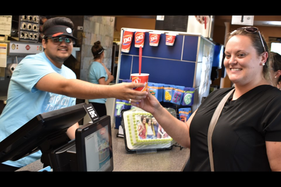 Keltie Smith, receiving her treat from Harsh Patel, was one of many who dropped into Orillia's Dairy Queen today to buy a Blizzard - not just to beat the heat, but to help raise money for a good cause. Today is Miracle Treat Day and that means net proceeds from every Blizzard Treat sold will be donated to a local Children's Miracle Network member hospital. You still have lots of time; Orillia's Dairy Queen (on Memorial Avenue) is open today until 10 p.m. Dave Dawson/OrilliaMatters