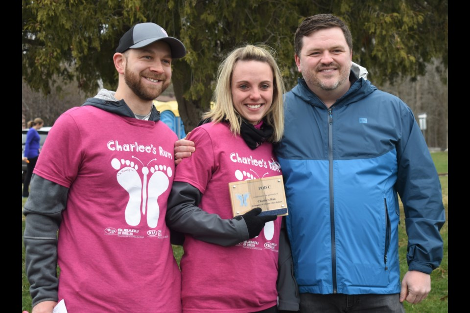 Dave and Mallory Holmes were overcome with emotion at last year's run when Orillia Soldiers' Memorial Hospital Foundation executive director Mark Riczu unveiled a plaque to honour their daughter and the legacy run named in her honour. Dave Dawson/OrilliaMatters