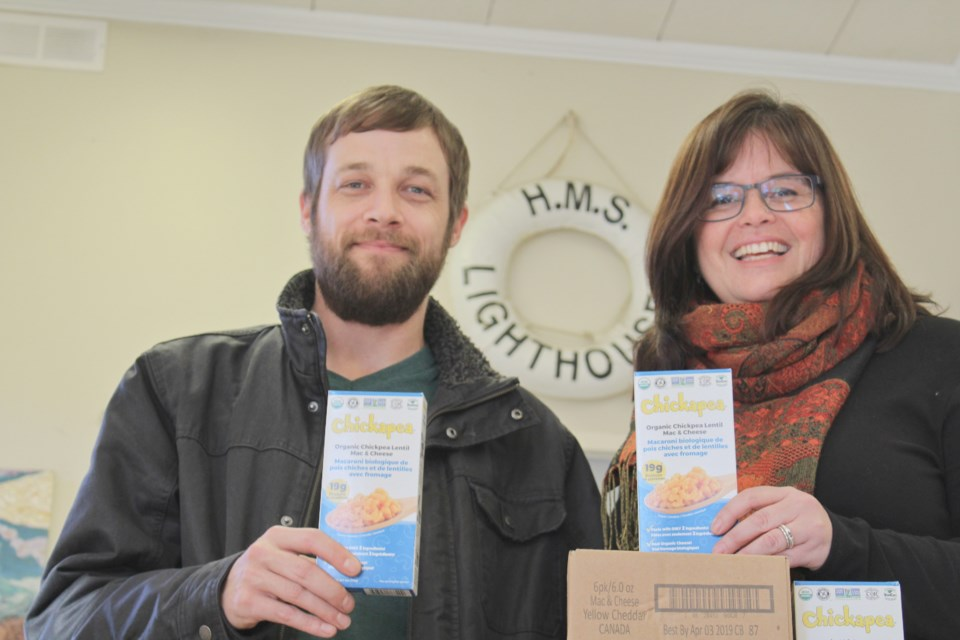 Nathan Taylor, a member of United Way Simcoe Muskoka's board of directors and GenNext team, is shown with Linda Goodall, executive director of the Lighthouse Shelter in Orillia. Taylor dropped off a donation of mac and cheese Tuesday on behalf of GenNext. Supplied photo