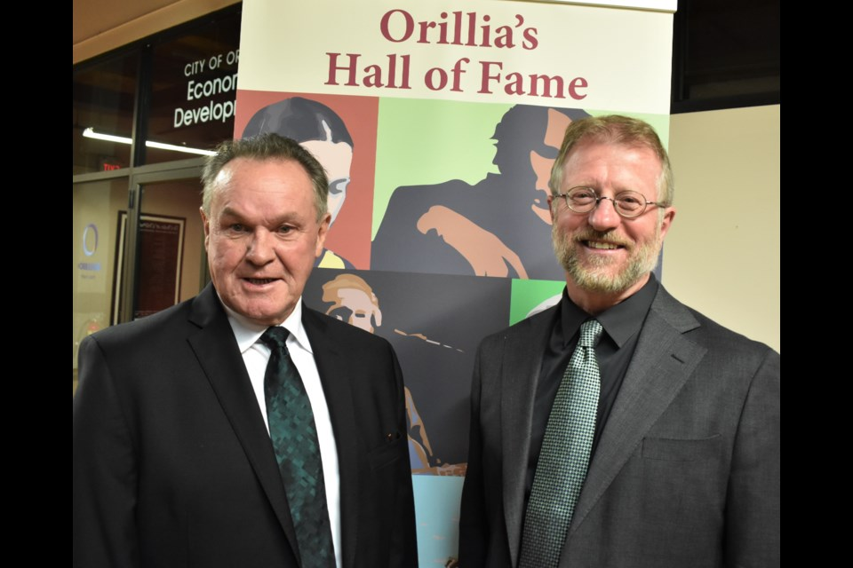 Rick Ley, left, and Jeff Hutchings, were feted outside city council chambers Monday night prior to being officially inducted into the Orillia Hall of Fame. Dave Dawson/OrilliaMatters