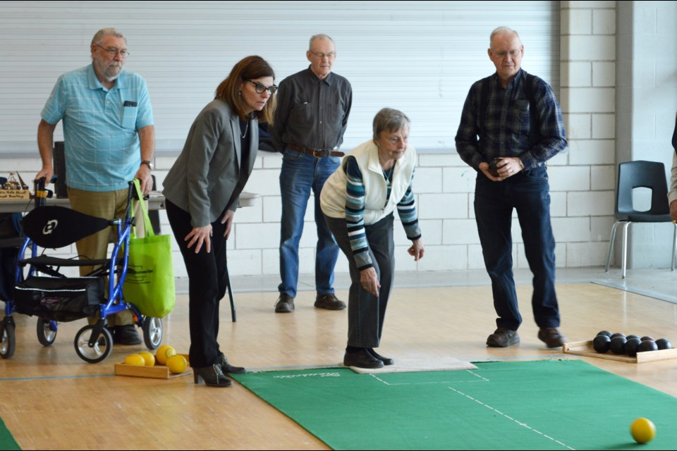 The Honourable Filomena Tassi, Minister of Seniors, (second on left) enjoys a game of carpet bowling with local seniors (from left to right) Rick Crouch, Bill Boyd, Ruth Flaherty and Harold Graham during her visit to Rotary Place on Wednesday. Supplied photo