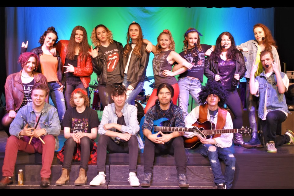 The performers and the band behind Thunder Rock pose for a photo prior to their dress rehearsal Saturday. The high-energy rock concert will be staged Wednesday and Thursday night at Twin Lakes. Dave Dawson/OrilliaMatters