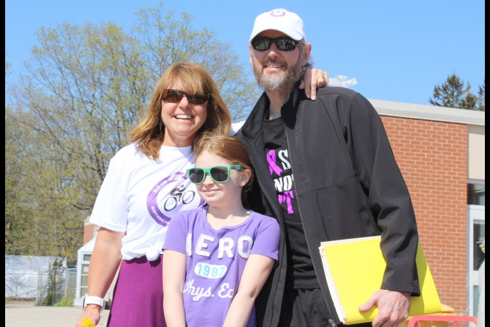 Jeff Munn is pictured with Guthrie Public School teacher Pamela Lee and student Lacey Pollock. The school held a bike-a-thon Wednesday to show its support for Munn, who has pancreatic cancer. Nathan Taylor/OrilliaMatters