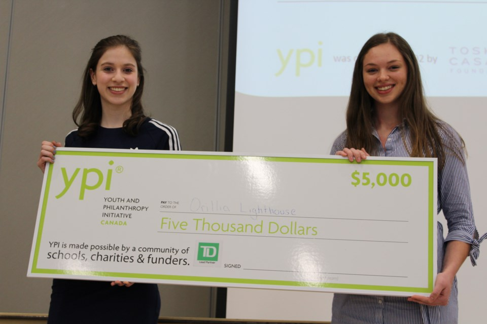 Andie Kaiser, left, and Meghan Sawatsky earned $5,000 for the Lighthouse during Wednesday's Youth in Philanthropy Initiative competition at Orillia Secondary School. Nathan Taylor/OrilliaMatters