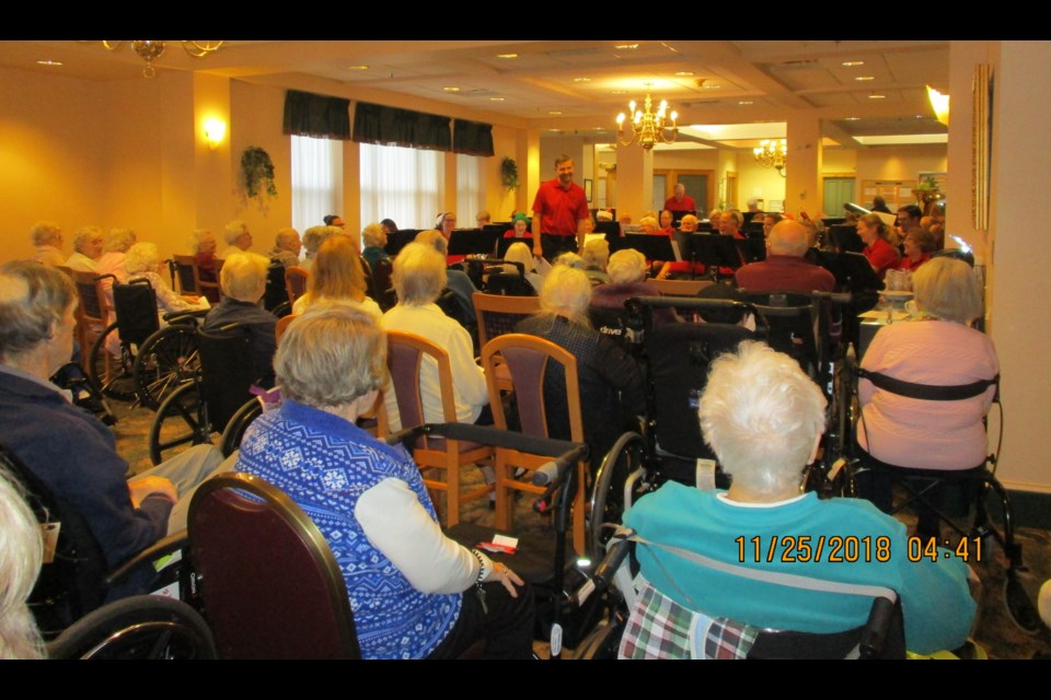 The sounds of the Christmas season rang out at Champlain Manor on Sunday, November 25, with a stellar performance from the 40-member Orillia Concert Band, directed by James Hilts. The dining room and front lobby were overflowing with many residents who enjoyed the hour-long performance. Contributed photo