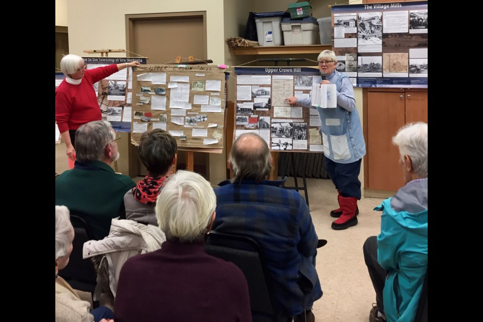 Sheila Craig, left, and Joanna McEwen are shown talking about the story board created for the history of Penetanguishene Road. They were the guest speakers at the Orillia Museum of Art and History's History Speaker Series recently. Supplied photo