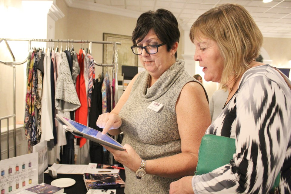 Shelle Hossack, left, president of the Orillia Business Women's Association, and Charlene Taylor, of Building Hope, did some shopping at Wednesday's OBWA business showcase. Nathan Taylor/OrilliaMatters