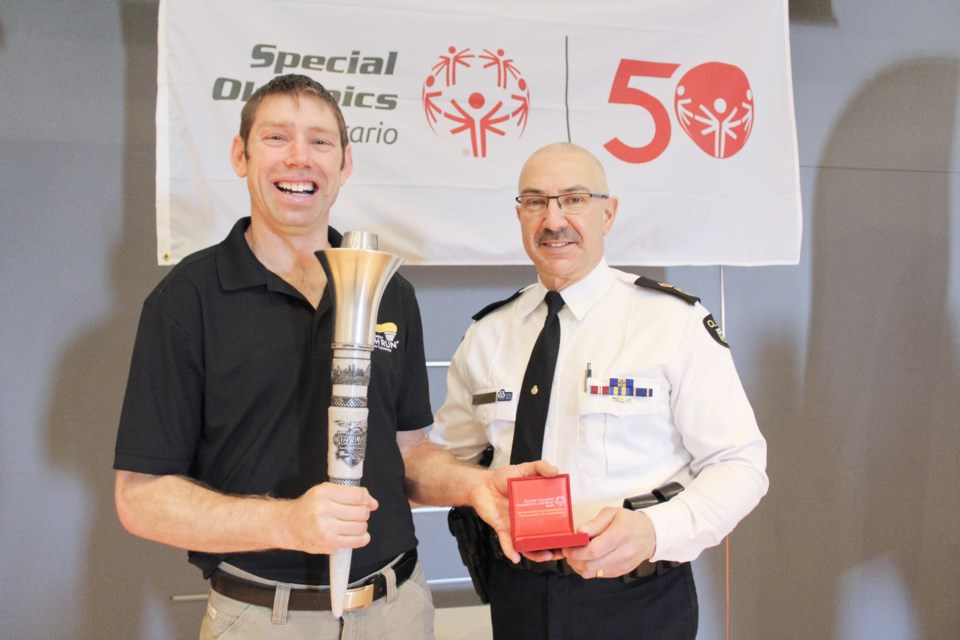 Special Olympian Stephen Graham is shown with Interim OPP Commissioner Gary Couture at OPP General Headquarters on Monday. Couture presented the Orillia athlete with the Special Olympics 50th-anniversary medal. Nathan Taylor/OrilliaMatters