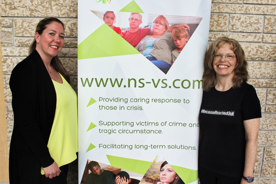 Melina Stoutt, left, is shown with Frances Yarbrough, executive director of North Simcoe Victim Services, during an event Thursday at OPP General Headquarters. Stoutt was sexually assaulted in 2011 and she is thankful for the support of victim services. Nathan Taylor/OrilliaMatters