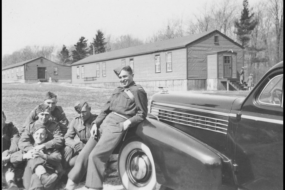 This is an historical image found in Camp 26. In this photo, members of the A squad are shown on duty in April of 1944.