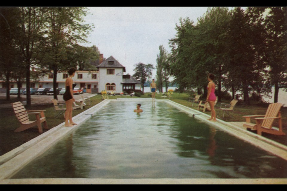 This photo showing the outdoor pool was taken circa 1956 by John R. MacIsaac, the owner of Owaissa Lodge.