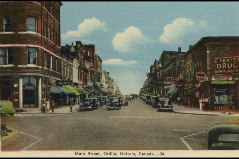 This postcard features the main street looking east, taken in the 1940s.