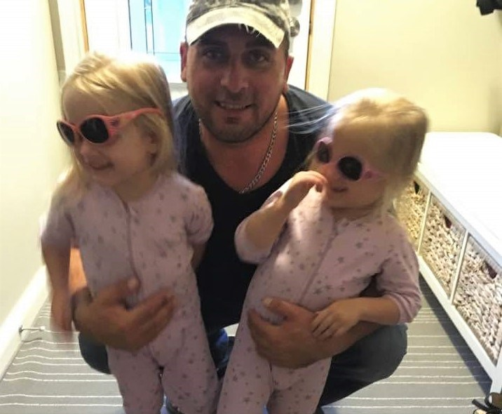 Mike Grelowski is shown in this Facebook photo with his twin daughters. He is in critical condition following Wednesday night's crash on Highway 11. Facebook photo