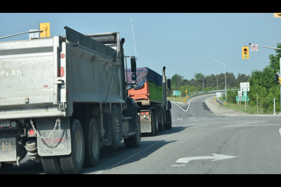 The OPP is conducting a commercial truck blitz on local highways. Above, two dump trucks make their way toward Highway 11. Dave Dawson/OrilliaMatters