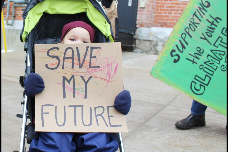 Two-year-old Bronwyn King took part in a climate strike Friday outside the Orillia City Centre. Nathan Taylor/OrilliaMatters