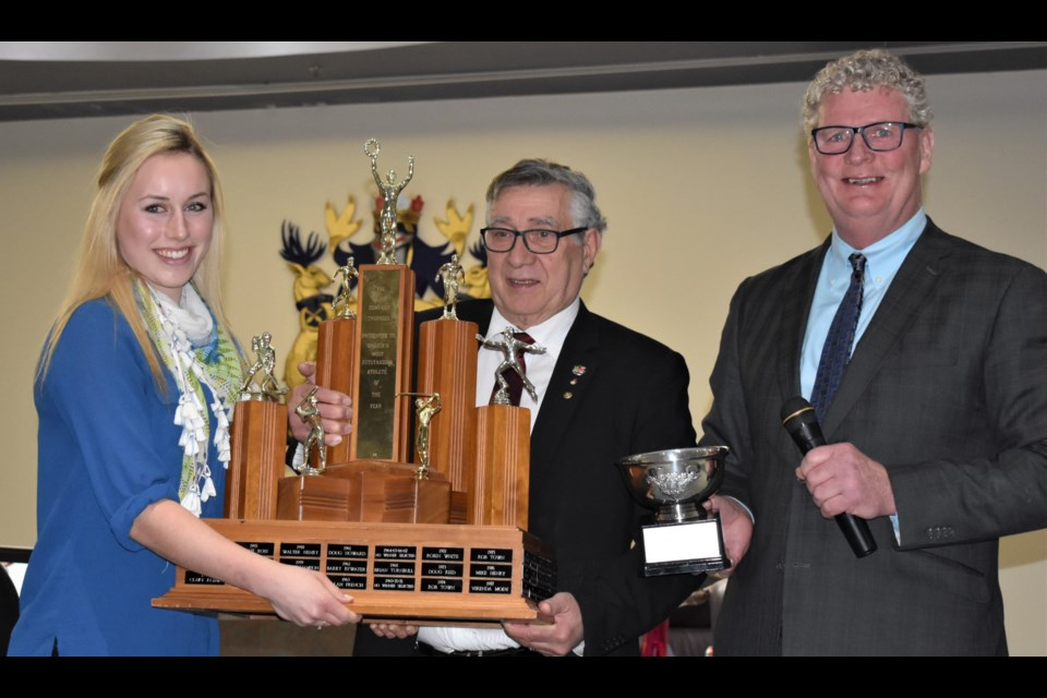 Ali Van Yzendoorn accepts the 2017 Orillia Athlete of the Year award from city councillor Ralph Cipolla and Orillia Mayor Steve Clarke at Monday night's city council meeting. Dave Dawson/OrilliaMatters