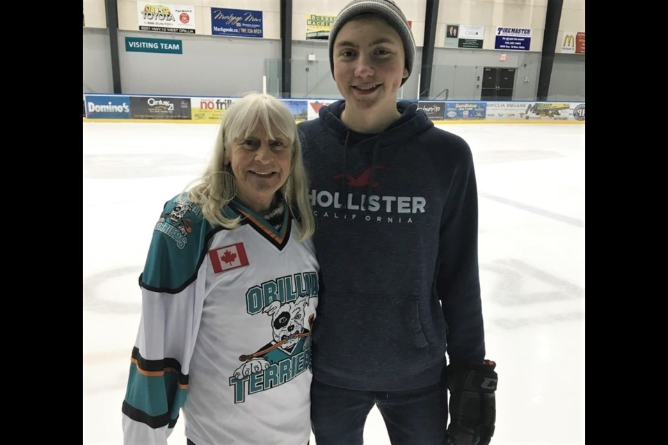 Gail Duck is shown with one of her on-ice assistants, Carter Metcalf, at the conclusion of the Mighty Mytes graduation game. Duck is retiring after 24 years of heading up the program. Supplied photo