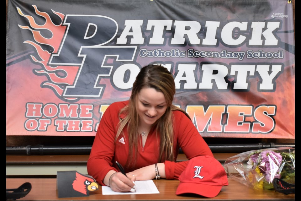 Hannah Morris, a Grade 12 student at Patrick Fogarty Catholic Secondary School, signs her National Letter or Intent to play for the University of Louisville Cardinals women's field lacrosse team. Dave Dawson/OrilliaMatters