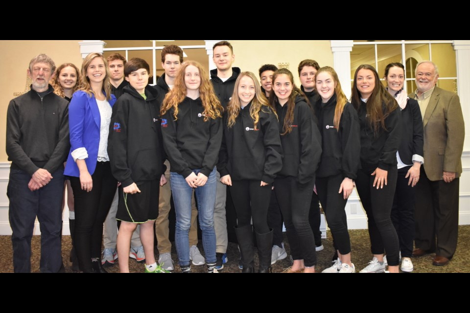 A dozen students from Orillia's three secondary schools were feted Thursday at the annual Breakfast of Champions hosted by Sport Orillia. The students are shown above with three of the four inductees entering the Orillia Sports Hall of Fame Saturday night: Ken 'Jiggs' McDonald, Brittany Fess and Jayme Davis. Dave Dawson/OrilliaMatters