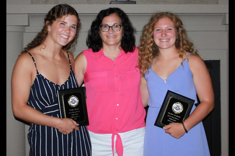 Annie Lloyd, left, and Rachel Mochulla, right, are flanked by Joanne Stanga, who presented each with the coveted award named in her honour.