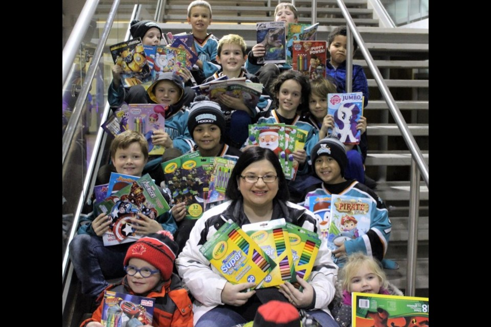 Angie Green-Hill decided to try to collect 500 colouring books and 500 packages of crayons for less fortunate kids this year. Members of the Julie Emery minor atom Terriers embraced the idea and recently donated 93 colouring books and 80 packs of crayons.