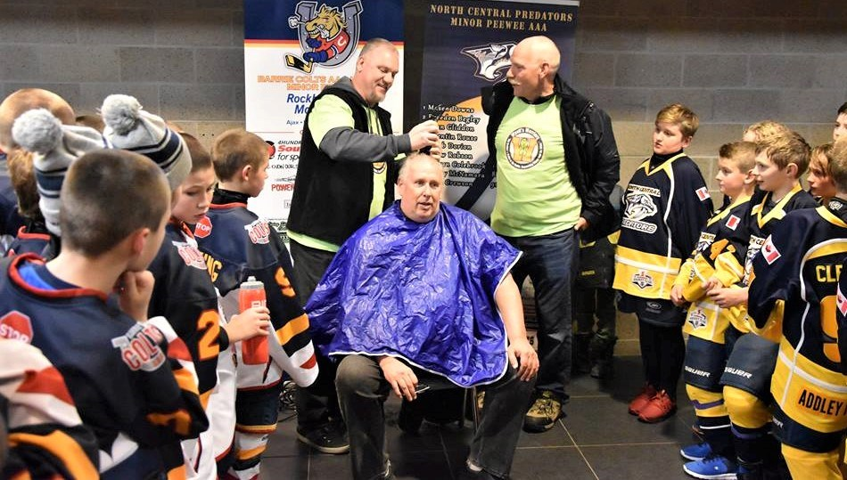 Roger Crandell, the president of the North Central Predators AAA hockey organization, gets his hair cut as part of a challenge to raise money for a Barrie hockey player fighting non-Hodgkins Lymphoma.