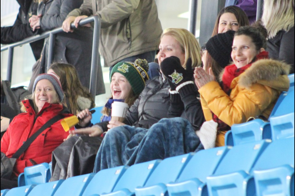 Parents and fans celebrate a goal Friday during a game between North Simcoe and Stoney Creek at Rotary Place, on the opening day of the 23rd annual Orillia Hawks girls hockey tournament. Nathan Taylor/OrilliaMatters