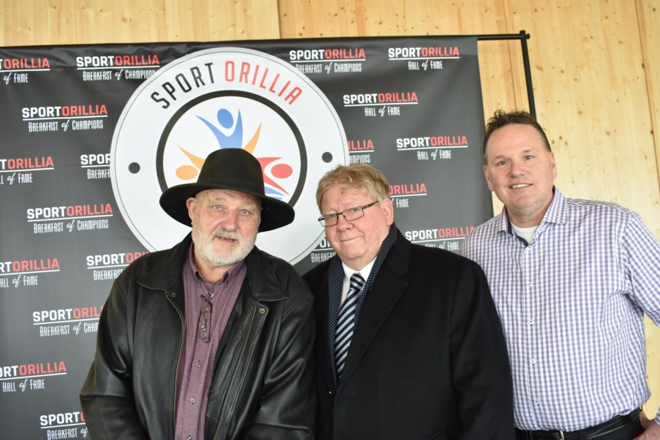 From left: Thom McGill, representing his late father, Bill McGill, Don Stoutt and Stuart Burnie were unveiled Tuesday as the latest inductees into Orillia's Sports Hall of Fame. Dave Dawson/OrilliaMatters