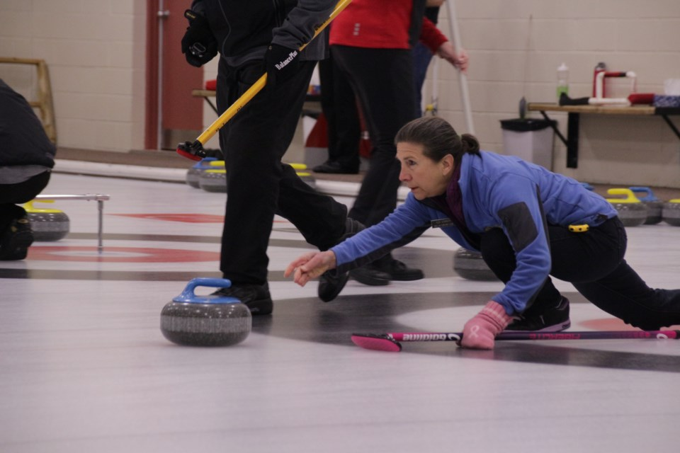 Ildi Connor, of Orillia, throws a stone during Saturday's mixed doubles curling bonspiel at the Barnfield Point Recreation Centre. Mehreen Shahid/OrilliaMatters