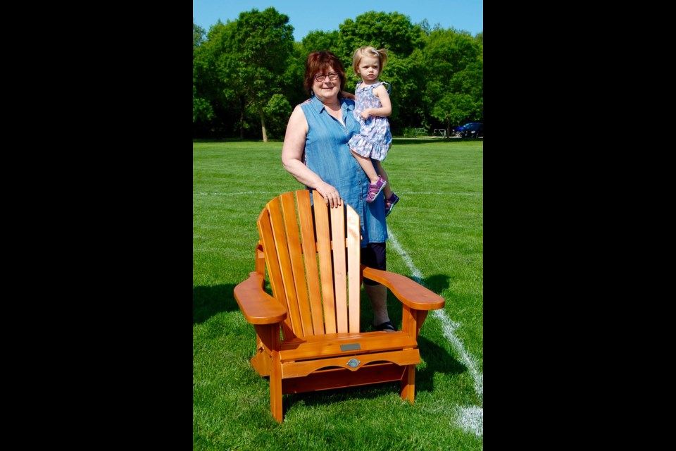 Isobel Hill, a volunteer for more than 30 years, was presented recently with this Muskoka chair on her retirement from the Orillia and District Soccer Club's board of directors. Contributed photo