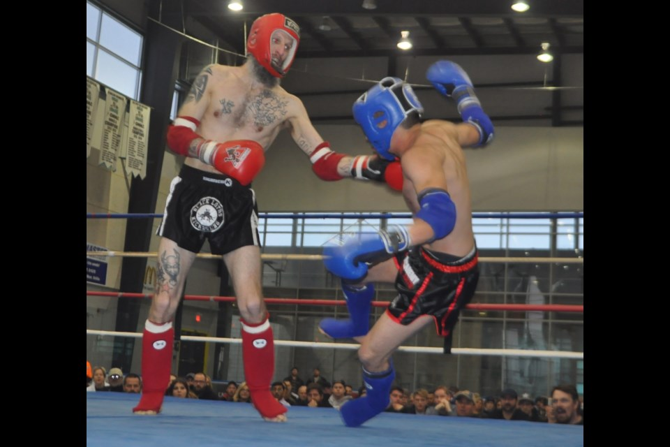 Nick Ryerse proved to be a hometown favourite in his match against Ottawa's Gabe Alamo at the first Muay Thai Night held at Rotary Place. Ryerse is shown landing a solid left  that led to a knockdown and a unanimous decision in the 125-pound division tilt. Andrew Philips/OrilliaMatters