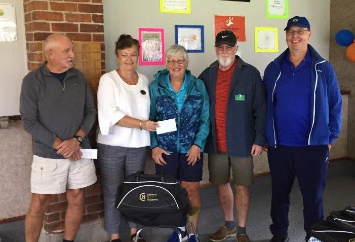 The winning team at Wednesday's Open Triples event was skip Lynn Smith, Gord Murphy and Barry Holloday, who are shown receiving their prizes from Leah Cavannah. Drawmaster Rick Swinton is on the far left.