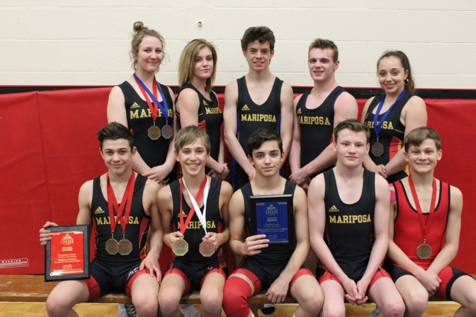 Local wrestlers shone on the national stage earlier this month. Front row, from left: Logan Smith, Cashius Aitken, Duncan Blake, Dom Ritchie and Jack Scott. Back row: Leigha Smith, Sam Cordery, Ian Stirling, Carson Bussieres and Zarah Yglesias. Contributed photo