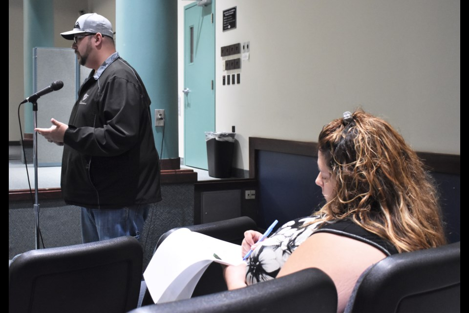 Derick Lehmann, an Uber proponent, spoke in favour of the service and addressed some concerns raised by Jennifer Denault, right, the owner of Orillia Taxi Service. Dave Dawson/OrilliaMatters