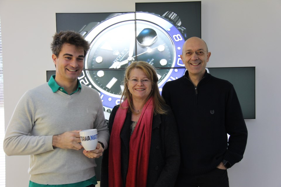 Gabriele Barbero, Marie-JoseeBegin and Filippo Gallino stand in front of one of their products. Alex Robinson/OttawaMatters