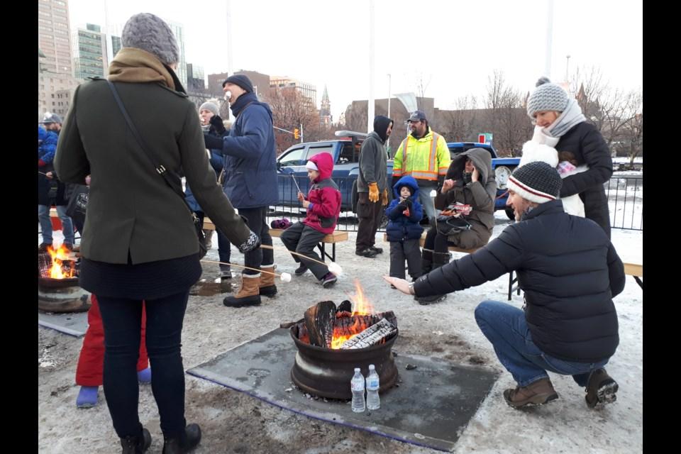 Roasting marshmallows on the fire. (Ryley White/ Ottawa Matters)