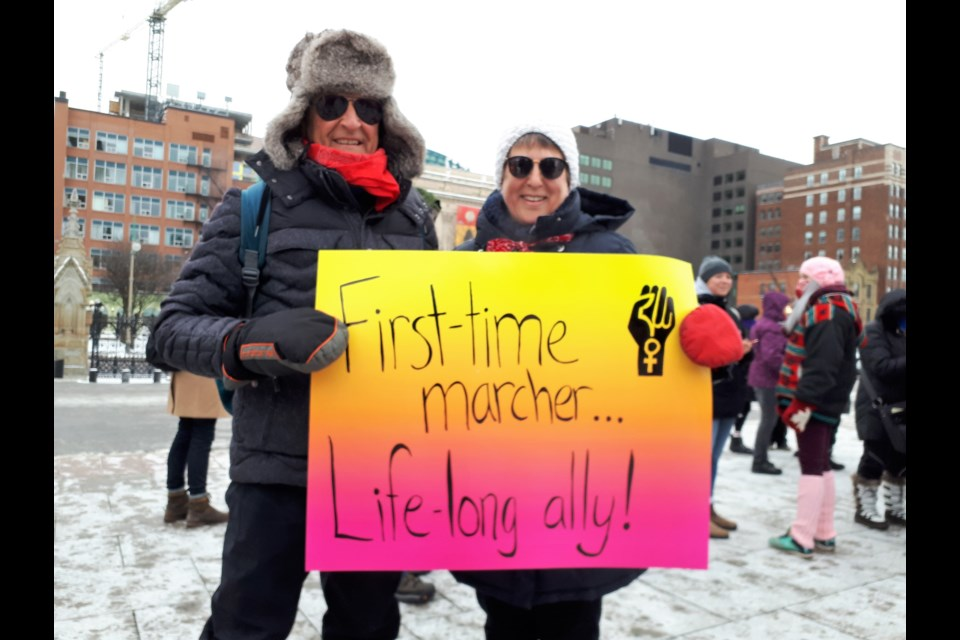 Many participants made their own signs for the march. (Ryley White/ Ottawa Matters)