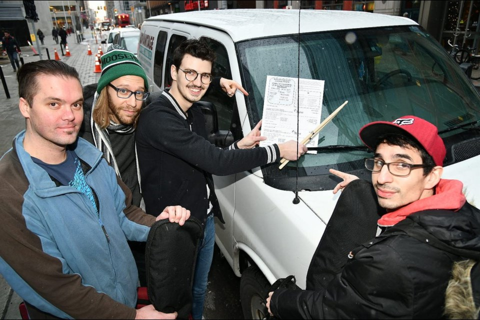 Artists at Queen St. Fare show off the city's new parking permit to help musicians. Photo/ City of Ottawa