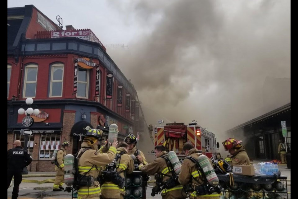 Firefighters continue to work at the scene of a blaze at 35 William Street in the ByWard Market, April 12, 2019. Jenn Pritchard/ OttawaMatters.com
