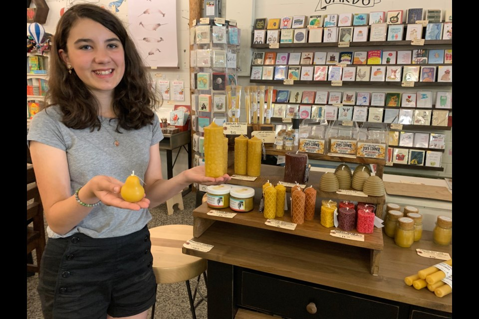 Anna Chandler Merlo, 12, holding her personal favourite handmade products on display at Maker House Co. on Wellington Street West. (Andrew PInsent/OttawaMatters.com)