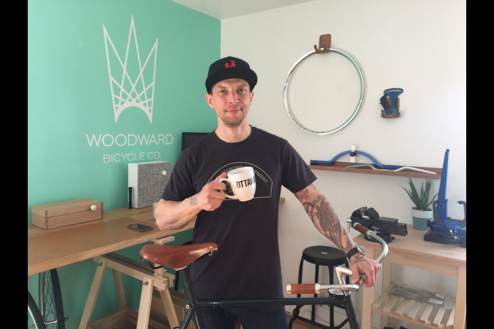 Lukasz Dybinski, owner and operator of Woodward Bicycle Co., pictured in his home workshop. (Andrew Pinsent/OttawaMatters.com)