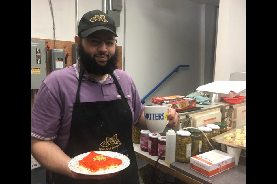 Aziz Sharkh, co-owner of Talluza Desserts in Ottawa. (Andrew Pinsent/OttawaMatters)
