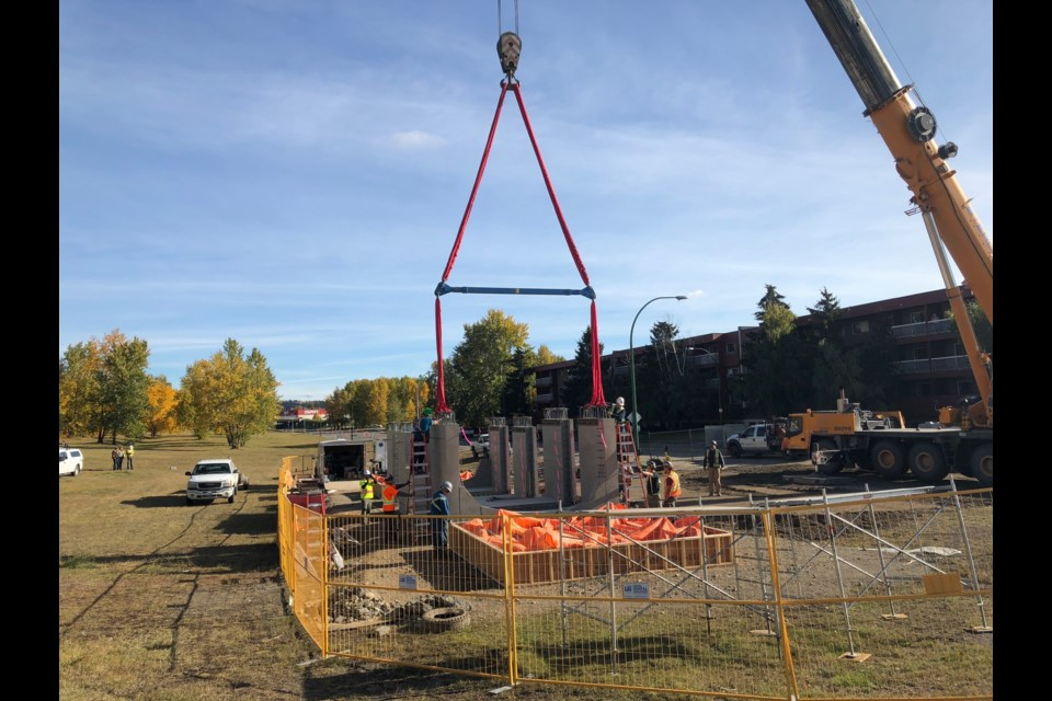 Crews work to install four sections of concrete chambers to replace the old sewer pipe that caused the sinkhole. (via Hanna Petersen)